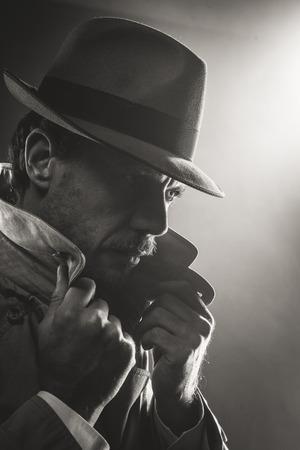 undercover agent: Film noir confident detective with borsalino hat, 1950s style
