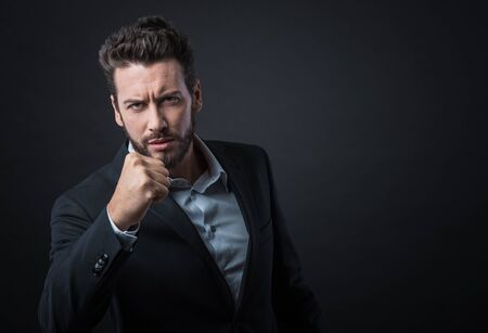 mans shirt: Angry aggressive businessman showing fists and ready to attack Stock Photo