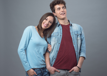 affinity: Happy young couple posing together and smiling at camera Stock Photo