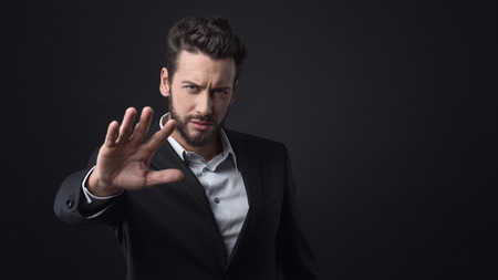 man's suit: Disappointed businessman expressing denial with open hand raised Stock Photo