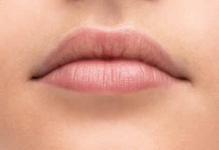 Beautiful young woman's full lips close-up, perfect skincare concept