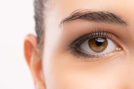 healthy looking: Beautiful womans brown eye close up looking at camera