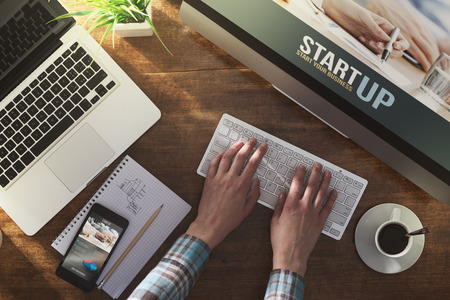 Start up corporate identity website on laptop, digital tablet and smart phone, business desktop