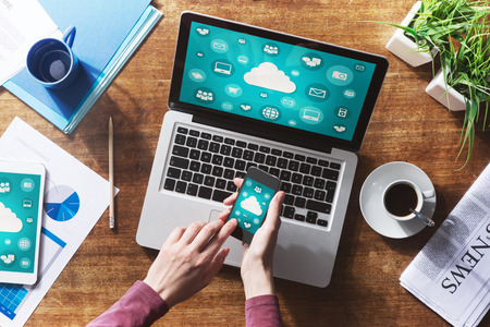 Cloud computing and social network interface on a laptop, tablet and smartphone screen photo