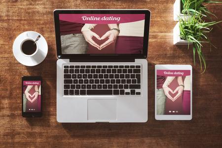 Online dating website on a laptop display, hardwood desktop on background