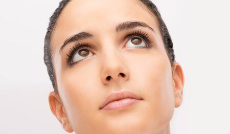 brown  eyed: Attractive young brown eyed woman portrait close-up