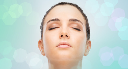 Beautiful young woman portrait with clean flawless skin and eyes closed Stock Photo