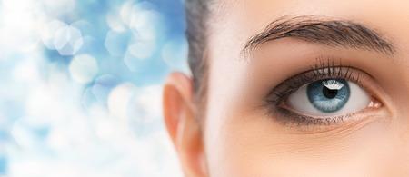 Beautiful womans blue eye close up looking at camera photo
