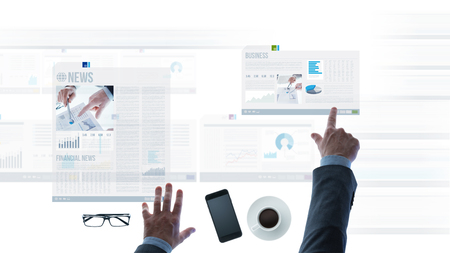 scrolling: Professional businessman pointing at financial reports and scrolling news slides on a touch screen light desk, hands close up Stock Photo