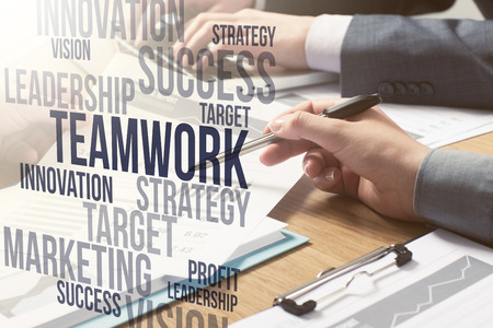 business concepts: Business people team working together at office desk, teamwork and marketing text concepts on the right Stock Photo