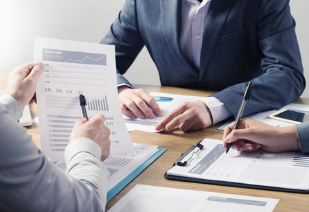 Financial service professional team at work, hands close with business reports and paperwork Stock Photo - 41135194