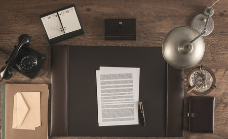 old desk: 1950s style office with a contract and a pen, top view Stock Photo