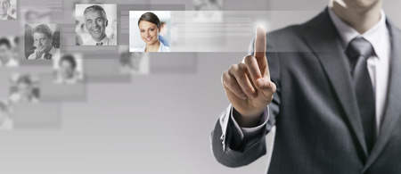 Businessman searching a user profile online and touching a touch screen interface