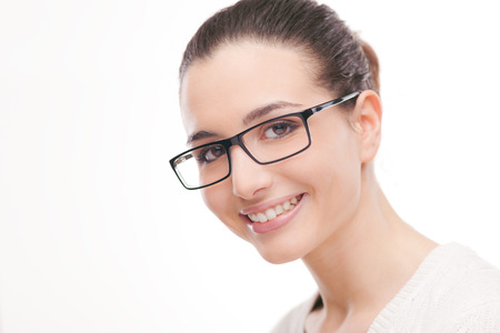 young woman smiling: Beautiful young woman wearing glasses and smiling at camera Stock Photo