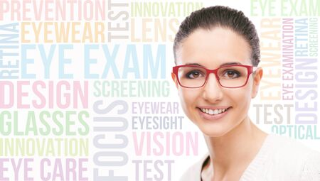 glasses model: Smiling young fashion model wearing red stilysh glasses, eye care concepts and words on background Stock Photo