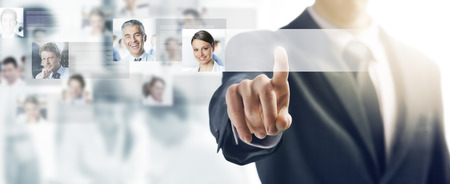 Businessman using a touch screen interface and pushing a button, people avatars and business team on background Stok Fotoğraf - 43016280