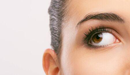 brown eye: Beautiful womans brown eye close up looking away