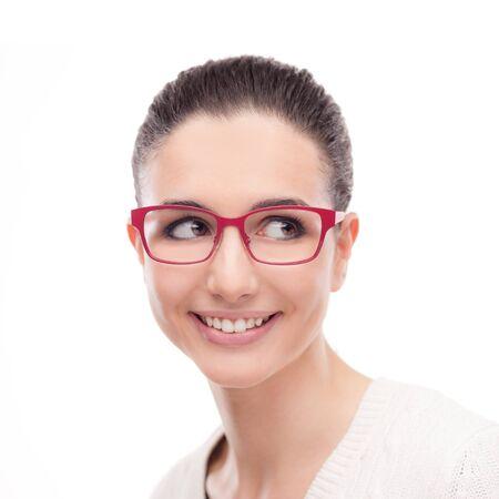 glasses model: Smiling young fashion model posing on white background wearing red stylish glasses Stock Photo