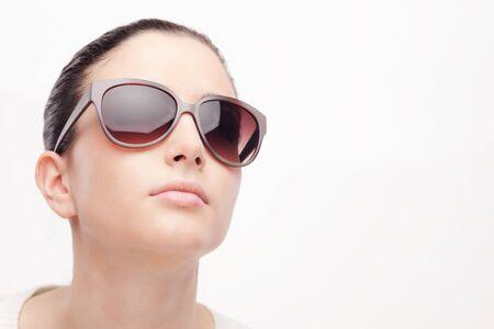 glasses model: Young female fashion model wearing big sunglasses on white background Stock Photo