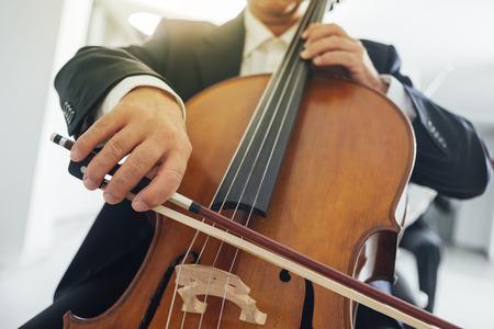 unrecognizable person: Professional cello players hands close up, unrecognizable person Stock Photo