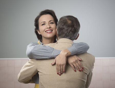 trust people: Happy vintage couple 1950s style smiling and hugging