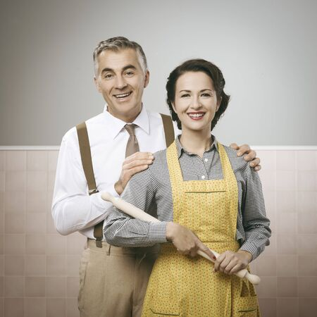 love life: Happy vintage couple at home posing and smiling at camera