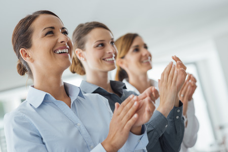 only women: Cheerful confident business women applauding and smiling, success and achievement concept