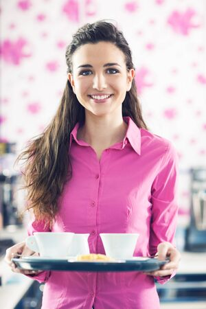 cafeteria tray: Young smiling waitress in pink shirt serving coffee at the bar, floral wallpaper on background