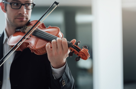 solo violinist: Talented violinist and classical music player solo performance, blank copy space on right Stock Photo