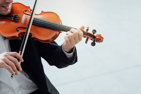solo violinist: Talented violinist and classical music player solo performance, blank copy space on the right