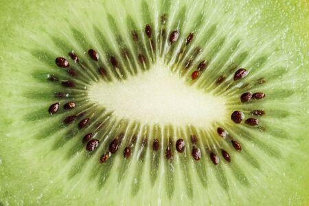 kiwi: Tasty sliced kiwi fruit close up, vitamin and nutrition concept