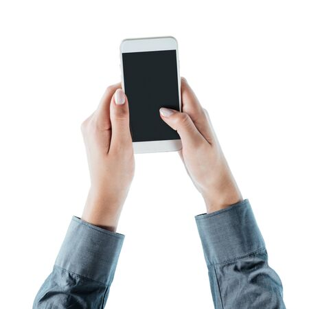 unrecognizable person: Business woman using a touch screen smart phone hands close up, top view, unrecognizable person Stock Photo