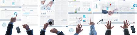 unrecognizable people: Business team checking financial news and reports on touch screen slides on a light table, unrecognizable people, top view Stock Photo