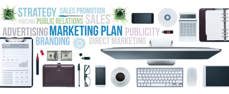 Marketing and communication concepts on a business desktop with computer, tablet and smartphone, top view Stock Photo