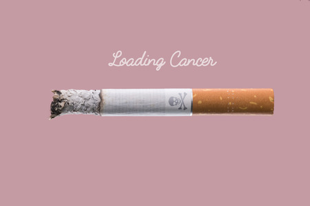 living skull: Stop smoking concept advertisement, cigarette burning as cancer loading bar with skull and bones symbol