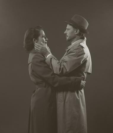 film noir: Film noir: romantic loving couple embracing in a foggy night, 1950s style