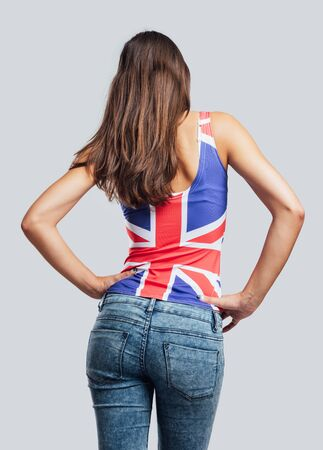 jean: Beautiful teenager girl back view, she is wearing a British flag tank top and jeans Stock Photo