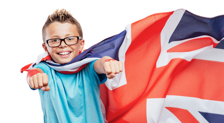 invincible: Smiling British super hero wearing a flag as a cape and flying with raised fists