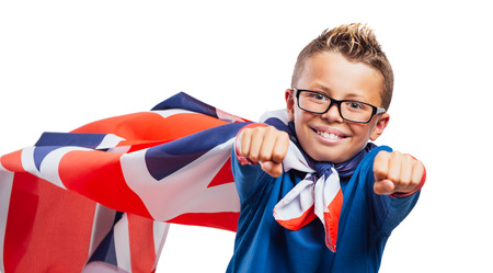 invincible: Smiling English super hero wearing a flag as a cape and flying with raised fists
