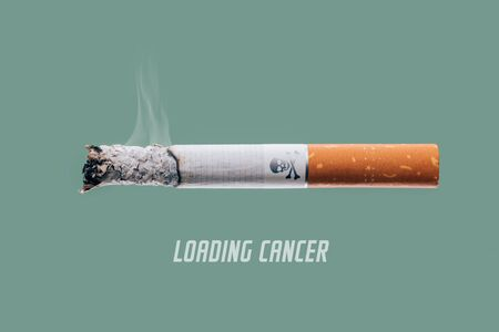 smoking issues: Stop smoking concept advertisement, cigarette burning as cancer loading bar with skull and bones symbol