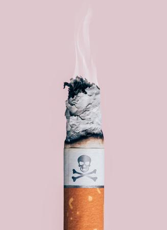 living skull: Cigarette burning with skull and bones symbol, smoke addiction and illness concept