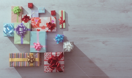 gift boxes: Plenty of colorful gifts on a wooden table top view , blank copy space, celebration and Christmas concept