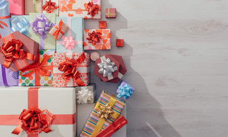 Lots of colorful gifts on a wooden table top view , blank copy space, celebration and Christmas concept