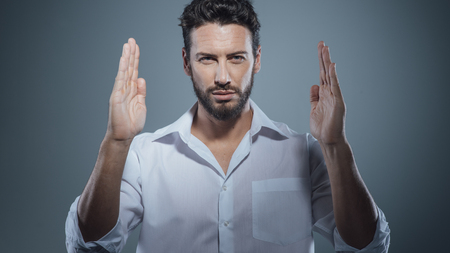 rolledup sleeves: Handsome young man with raised hands, measure concept
