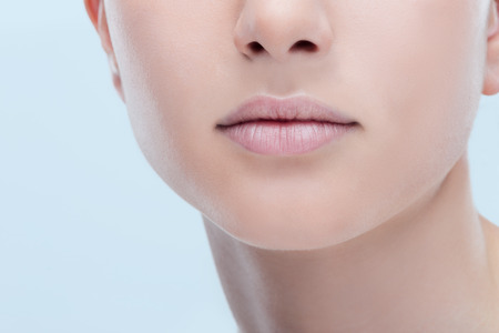 skincare: Beautiful young womans full lips close-up, perfect skincare concept