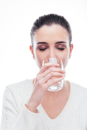 hydration: Young woman drinking a glass of fresh water, body hydration concept Stock Photo