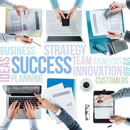 unrecognizable people: Business text concepts and business team working at office desk during a meeting, hands top view, unrecognizable people, strategy and teamwork concept Stock Photo
