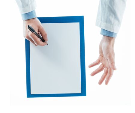 explanations: Doctor writing a prescription and giving explanations on white background, top view
