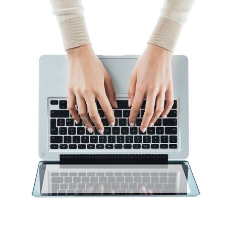 view girl: Business woman typing on a laptop keyboard on white background, top view, hands close up