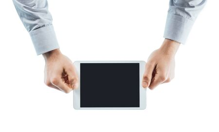 working hands: Businessman using a digital tablet hands close up with copy space, unrecognizable person Stock Photo